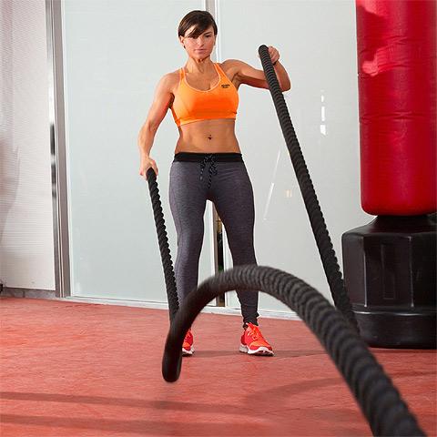 Girl using battle ropes