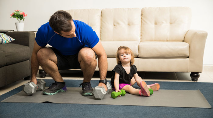 Father and daughter doing exercise