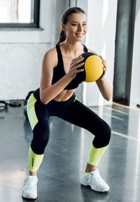 doing squat with medicine ball