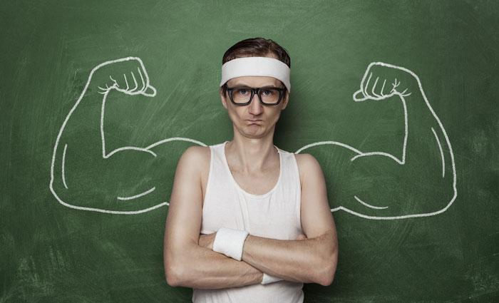 man with muscles in blackboard