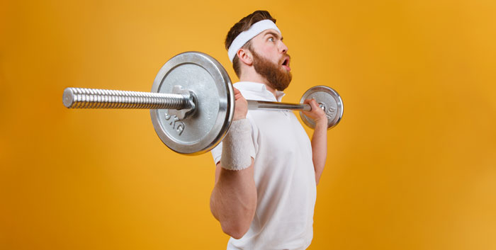 How to Breathe when Lifting Weights - young man lifting heavy