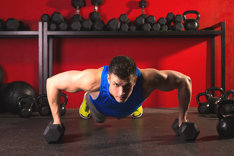 Guy doing dumbbell push-ups
