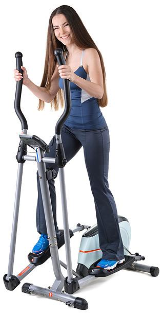 Girl on cross trainer