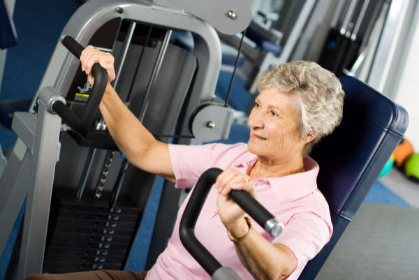 Senior lady on exercise machine